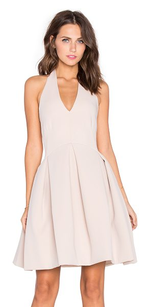 Halston Fit & flare halter dress in blush - Self: 95% poly 5% spandexLining: 100% poly. Dry clean...