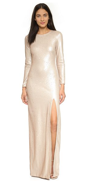 HALSTON Sequin gown with high slit in buff/gold - Allover sequins lend sparkle to this dramatic Halston...