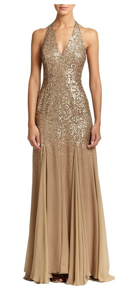 Halston Sequin-top halter gown in gold - A luminous sequined bodice tops this fluid georgette...