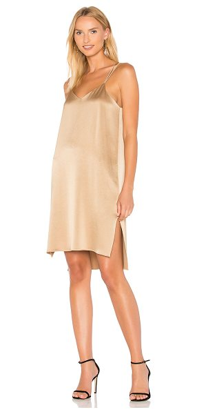 Halston Slip Dress in camel - Poly blend. Dry clean only. Fully lined. Side seam...