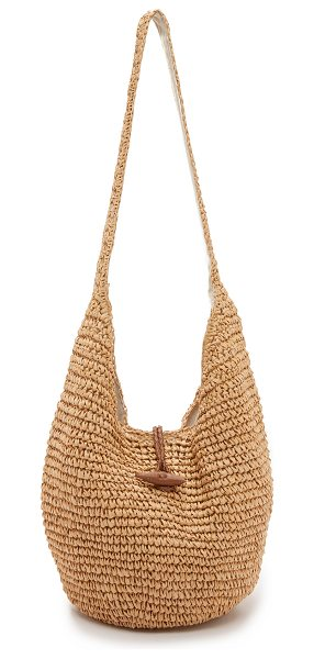 Hat Attack toggle sling bag in natural - A leather toggle closure fastens the magnetic top line...