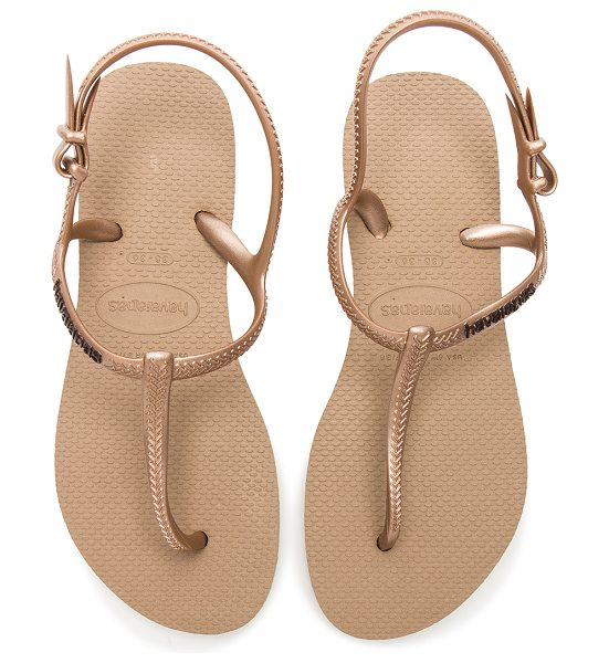 Havaianas Freedom Slim Sandal in metallic gold - Rubber upper and sole. Ankle strap with buckle closure....