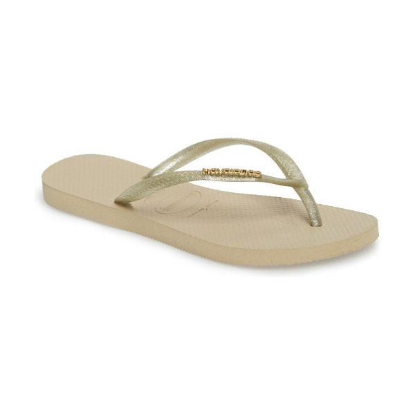 Havaianas 'slim logo' metallic flip flop in sand grey/ light gold