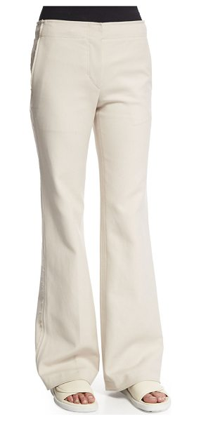 Helmut Lang Raw Seam Flare-Leg Pants in oyster - Helmut Lang pants with raw seam details. Side slash...