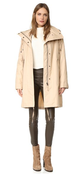 Helmut Lang utility fur lined coat in sand - A minimalist Helmut Lang coat with a twill shell and a...