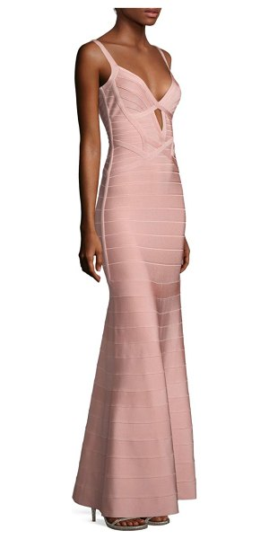 Herve Leger sleeveless v-neck gown in petal - A front cutout details this fitted knit gown.V-neck....