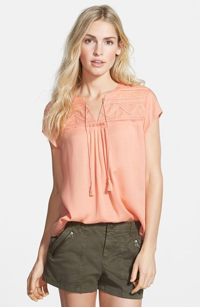 Hinge embroidered yoke top in coral pink - Fringe-tipped tassels sway from the split neckline of a...