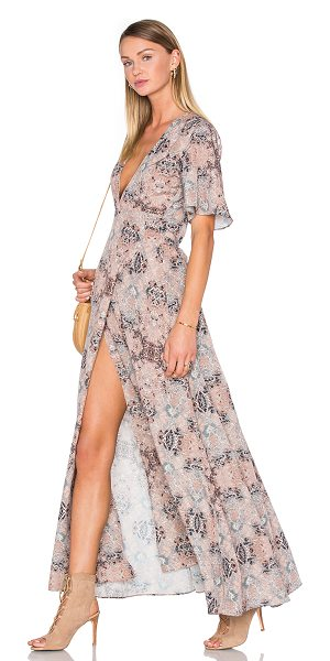 House of Harlow 1960 x REVOLVE Blaire Wrap Maxi in nude - 100% poly. Hand wash cold. Unlined. Wrap front with tie...