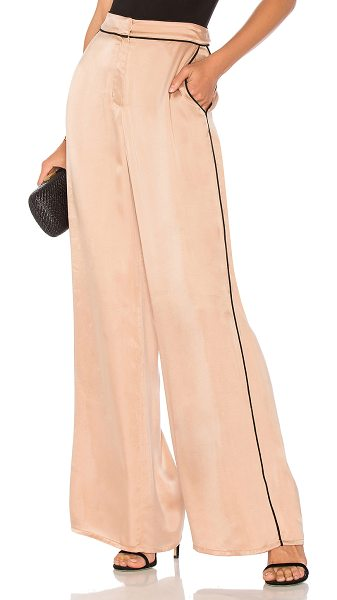 "House of Harlow 1960 x REVOLVE Mona Pant in beige - ""Poly blend. Hand wash cold. Zip fly with hook and bar..."