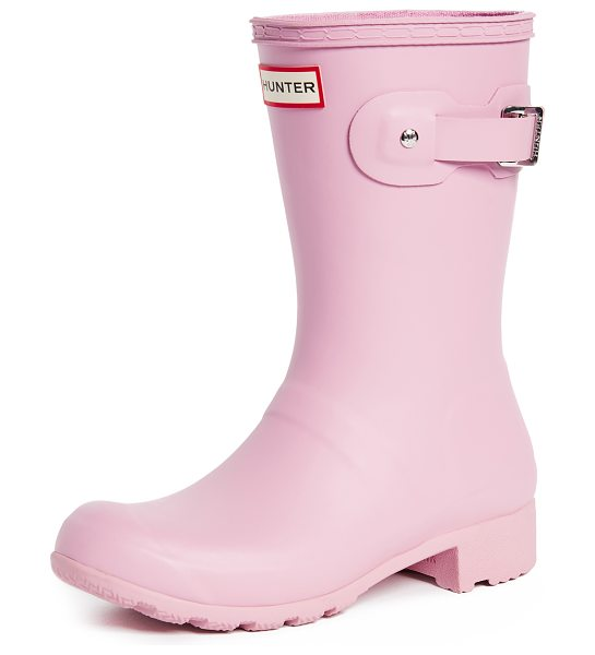 Hunter original tour short boots in blossom - Fabric: Rubber Buckle strap at side Mid-calf boots Flat...