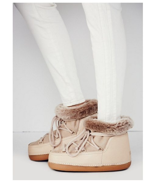 IKKII weather boot in cream - Lace up and step into the season with these handmade...