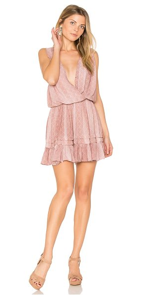 Indah Balmy Mini Dress in pink - 100% rayon. Partially lined. Crossover front with snap...