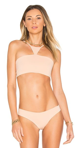 Indah Eminent Top in peach - 80% polyamide 20% elastane. Hand wash cold. Stretch fit....