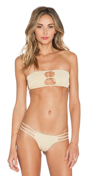 Indah Moto bikini top in metallic gold - 70% nylon 30% spandex. Hand wash cold. Stretch fit....