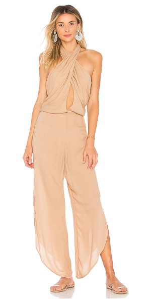 """Indah Pearl Jumpsuit in tan - """"100% viscose. Hand wash cold. Criss-cross front with..."""