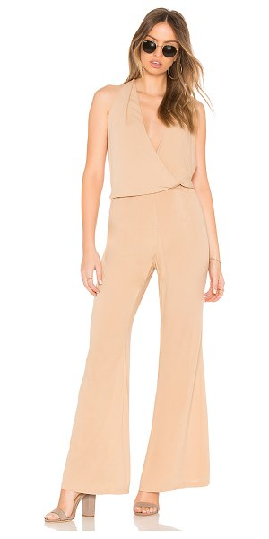 "Indah Smoke Cross Front Jumpsuit in beige - ""100% viscose. Hand wash cold. Halter ties around neck...."