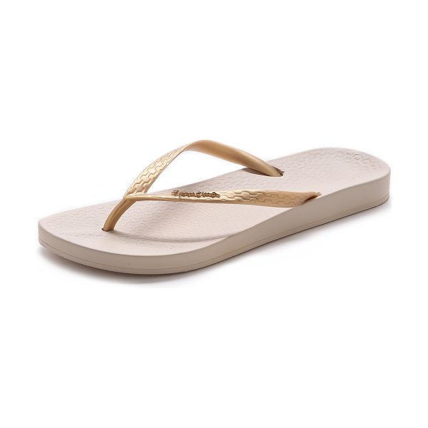 Ipanema Ana tan flip flops in beige/gold - A light metallic wash adds subtle shimmer to rubber...