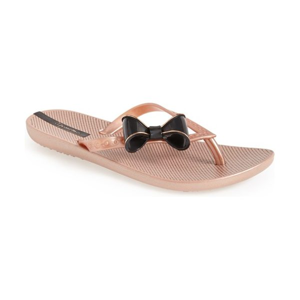 Ipanema neo clara flip flop in rose gold/ black - A pretty bow tops a flexible, summer-ready flip-flop...