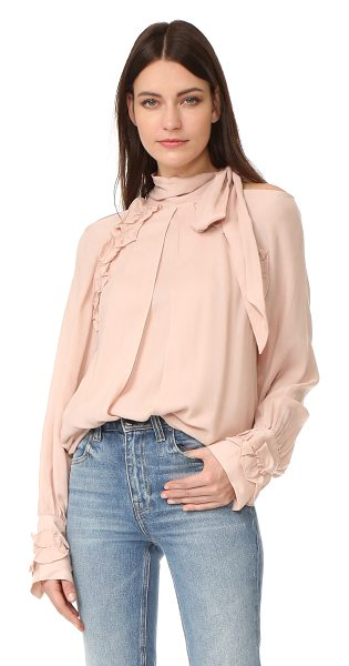IRO frejan blouse in pink sand - Gathered ruffles trim the raglan seams and button cuffs...