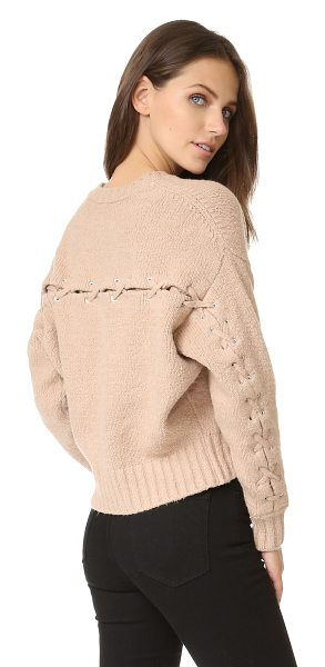 IRO lish sweater in nude - A lace up vent cuts over the back and long sleeves of...