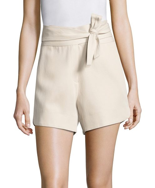 IRO magik tie-front shorts in sand - Front self-tie belt wraps waist of dolphin-hem shorts....