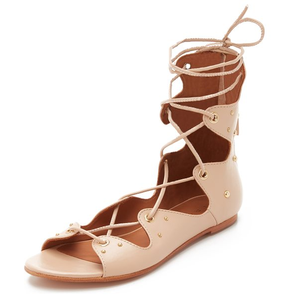 IRO Xiri lace up gladiator sandals in light pink - Polished studs and a scalloped top line accent these...