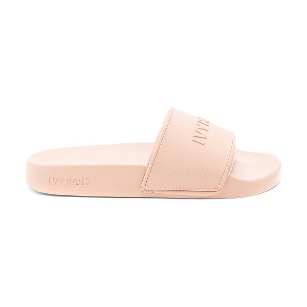 IVY PARK Logo Slides in beige - Man made upper and sole. Slip-on styling. Embossed logo...