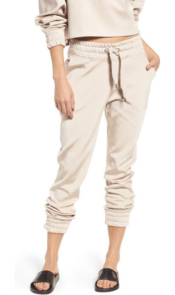 IVY PARK satin jogger pants in taupe
