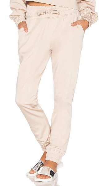 IVY PARK Satin Jogger in taupe - Self: 83% polyamide 17% elastaneBack: 100% cotton....