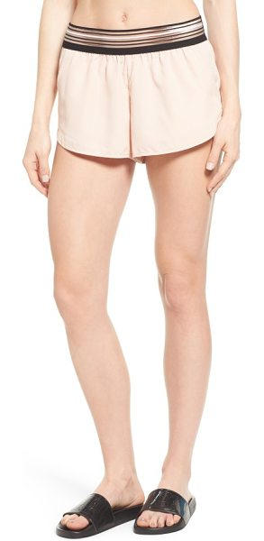 IVY PARK stripe elastic runner shorts in blush - An illusion-style striped waistband gives a modern feel...