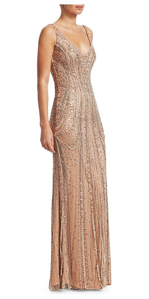Jenny Packham beaded tulle sleeveless gown in gold - This enchanting sleeveless gown flaunts a provocative...