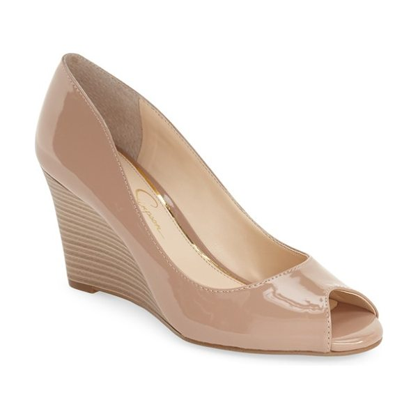 JESSICA SIMPSON lorion peep toe wedge - A stacked-woodgrain wedge supports a glossy patent pump...