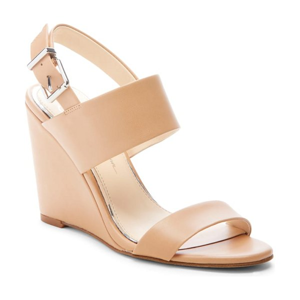 Jessica Simpson wyra wedge sandal in brown - Step out in modern, sophisticated style in this lofty...