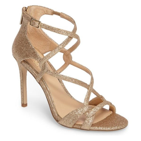 JEWEL BADGLEY MISCHKA aliza strappy glitter sandal in gold - Sinuous straps crisscross atop a glittery party sandal...