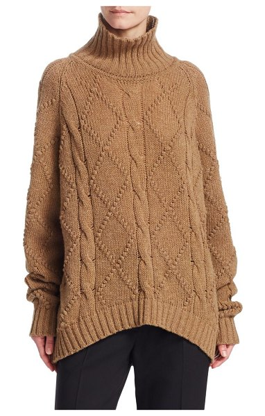 Jil Sander wool high-neck knit sweater in beige - The coziest cold weather essential, this cable-knit...