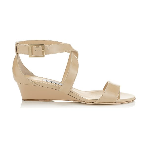 Jimmy Choo CHIARA Nude Patent Leather Wedge Sandals in nude - The perfect easy to wear sandal, the Chiara sports a low...