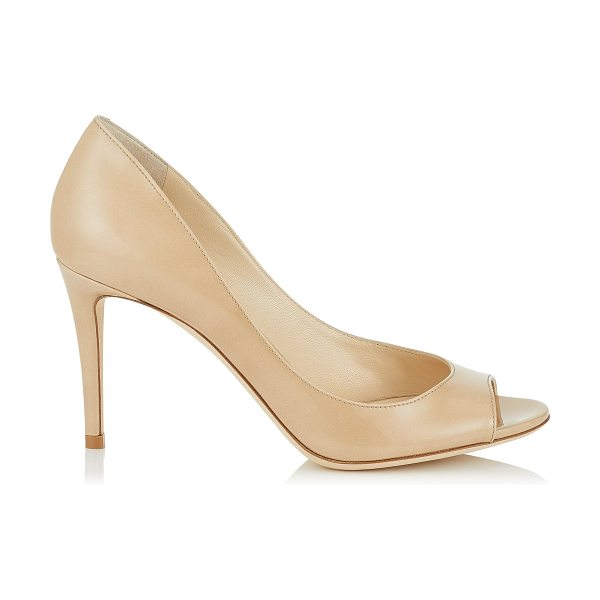 Jimmy Choo EVELYN 85 Nude Patent Leather Peep Toe Pumps in nude - A versatile and contemporary peep toe pump on a wearable...