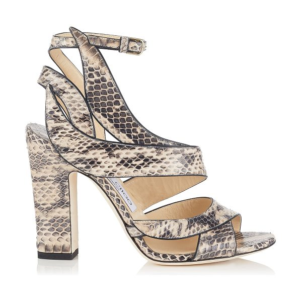 Jimmy Choo FALCON 100 Nude Elaphe Sandals in nude - In nude elaphe, the Falcon sandal portrays a powerfully...