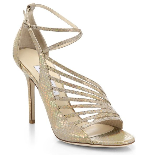 Jimmy Choo Florry holograph snakeskin-embossed leather asymmetrical strappy sandals in lightgold - A holographic finish ensures that these strappy,...