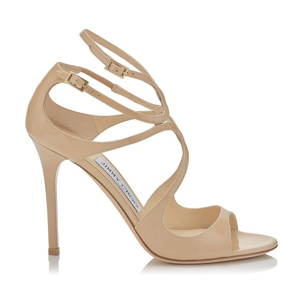 Jimmy Choo LANG Nude Patent Sandals in nude - The statuesque Lang sandal is an elegant tangle of ankle...