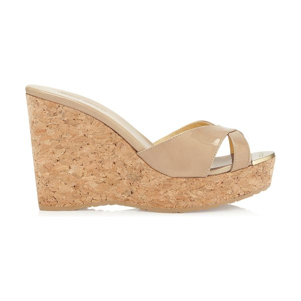 Jimmy Choo PANDORA Nude Patent Leather Wedge Sandals in nude - A pair of nude wedge sandals are a holiday must have....