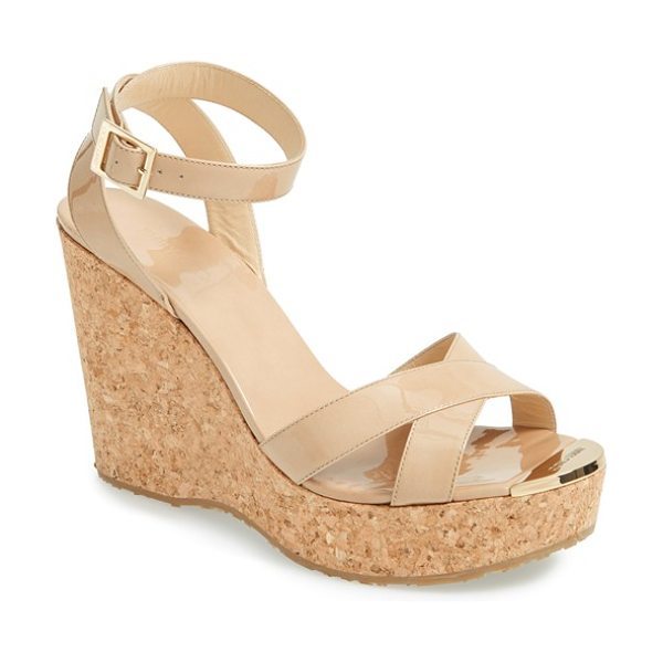 JIMMY CHOO papyrus cork wedge sandal in nude - An earthy cork wedge lifts a polished strappy sandal...