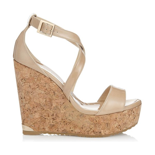 Jimmy Choo PORTIA 120 Nude Patent Leather Cork Wedges in nude - The Portia wedge sandal in nude patent leather provides...