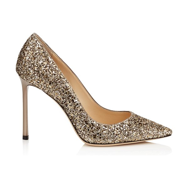 Jimmy Choo ROMY 100 Antique Gold Coarse Glitter Pointy Toe Pumps in antique gold - The ever-classic Romy heel gets a statement update with...
