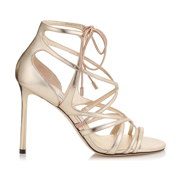 JIMMY CHOO TESS 100 Champagne Mirror Leather Strappy Sandals - A flatteringly intricate strappy sandal. The delicate...