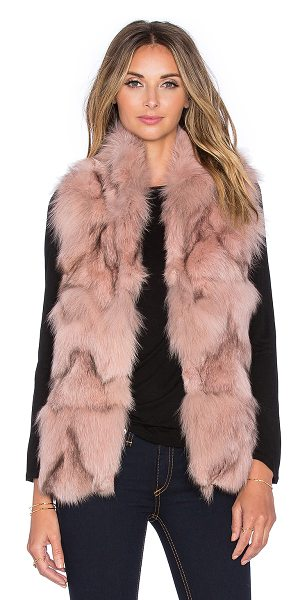 Jocelyn Stand collar fox fur vest in pink - Self: 100% dyed blue fox sectionsLining: 100% poly. Fur...