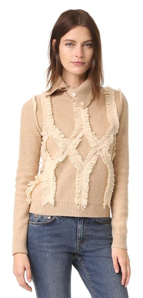 Jonathan Simkhai shredded argyle turtleneck in nude - Thick fringe brings unique texture to this Jonathan...