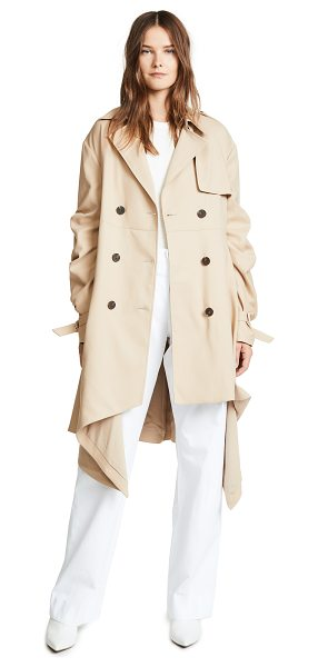 JONATHAN SIMKHAI tucked sleeve trench coat in khaki - Fabric: Suiting Asymmetrical hem Ruched sleeves Long...
