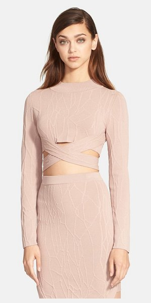 Jonathan Simkhai wrap spill intarsia knit mock neck top in sahara rose - A sultry, cropped mock-neck top features a wraparound...