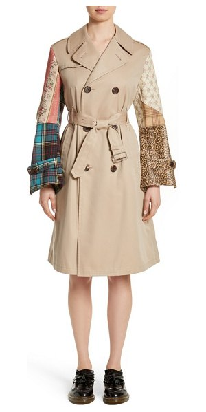 JUNYA WATANABE patterned sleeve trench coat in beige x mix - Flared patchwork sleeves add playful, feminine structure...